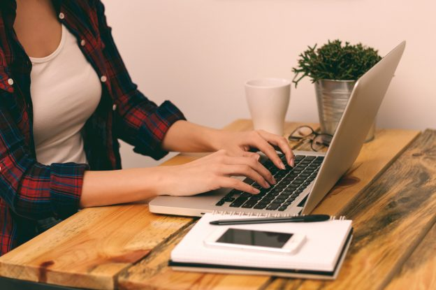 woman writing blog at desk