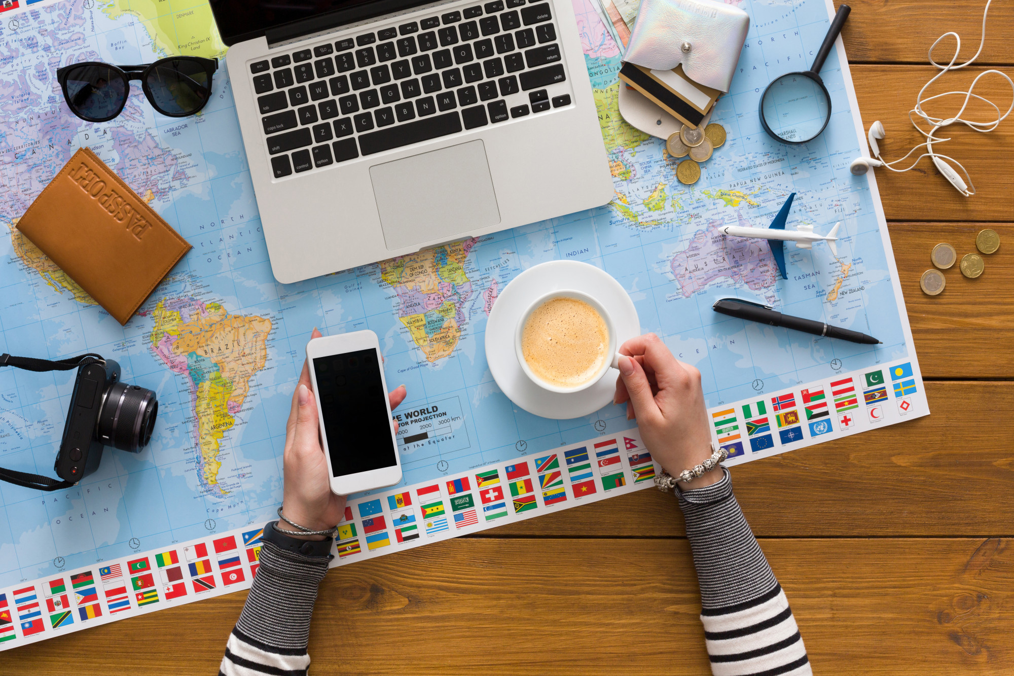 travel blogger with map and computer