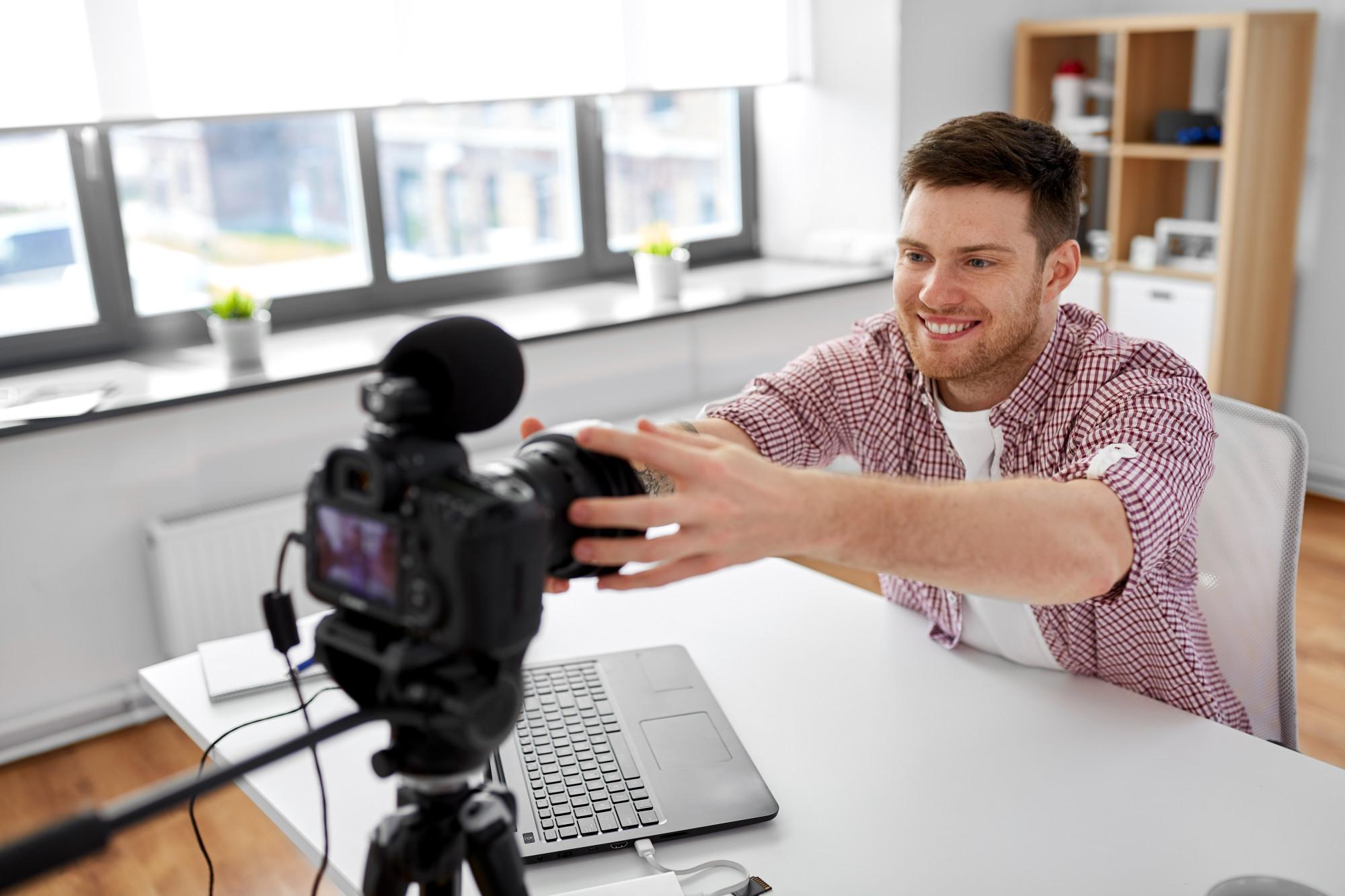 man making video