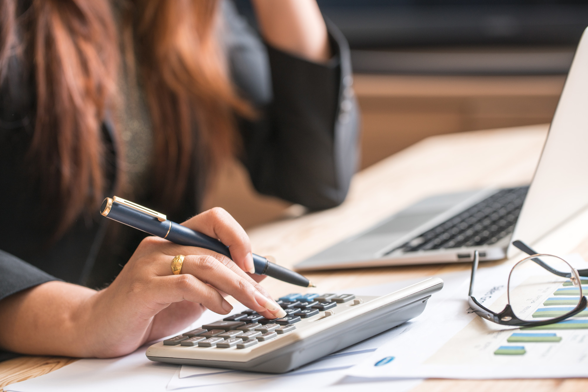 Small Business Owner Handling Finances