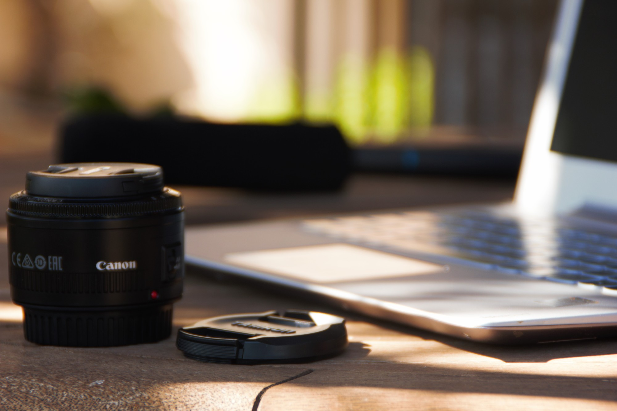 Camera Lens and a Laptop
